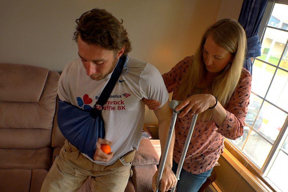After a bear mauled him last Friday, Hannah Steck helps her husband Kenny Steck on May 18, 2016. (Scott Jensen / Alaska Dispatch News)