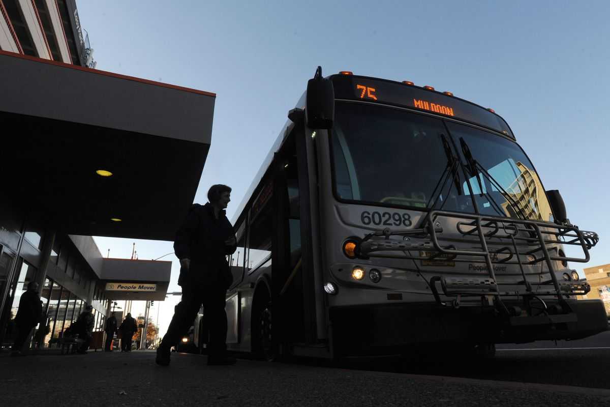 People board a bus at the Downtown Transit Center in Anchorage on Tuesday, Oct. 17. People Mover will launch a new bus system on Monday. (Bill Roth / Alaska Dispatch News)
