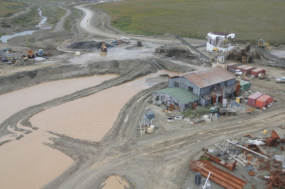 The processing facility of the Platinum Creek Mine sits alongside the settling pond August 2011. (Mark Lisac)