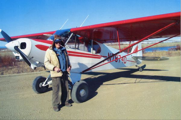 Warren Thompson stands next to the Piper PA-18 Super Cub he used for instruction and many rescue missions in Northwest Alaska.