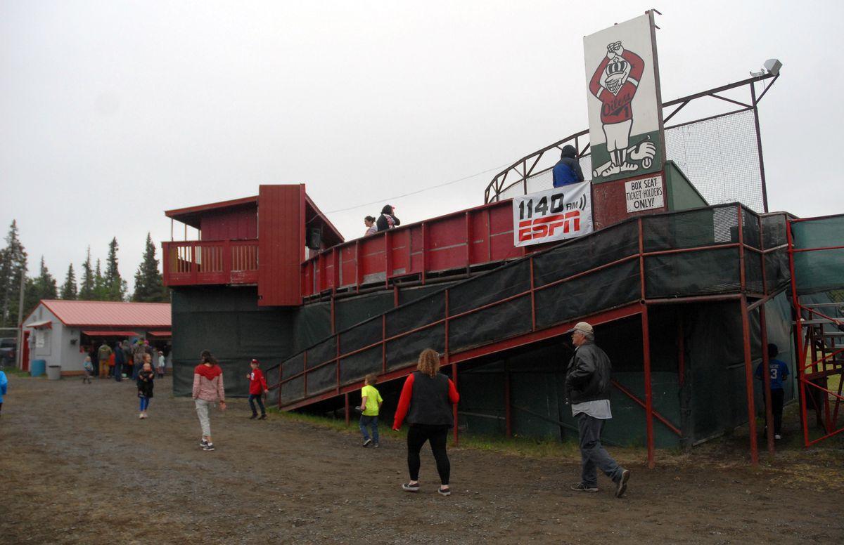Fans walk around the Coral Seymour Memorial Park in Kenai during an Alaska Baseball League game last month. (Matt Tunseth / Chugiak-Eagle River Star)