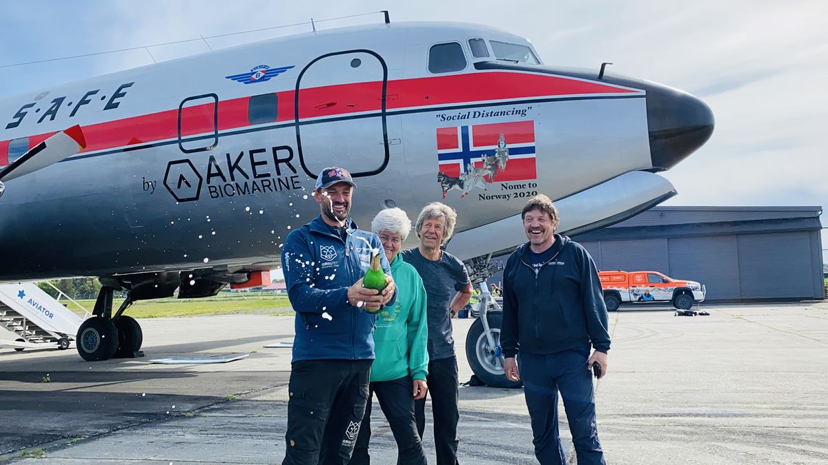 Thomas Waerner celebrates his return to Norway on Tuesday after a 20-hour flight from Fairbanks on a historic DC-6 cargo plane. (Photo provided by QRILL Paws)