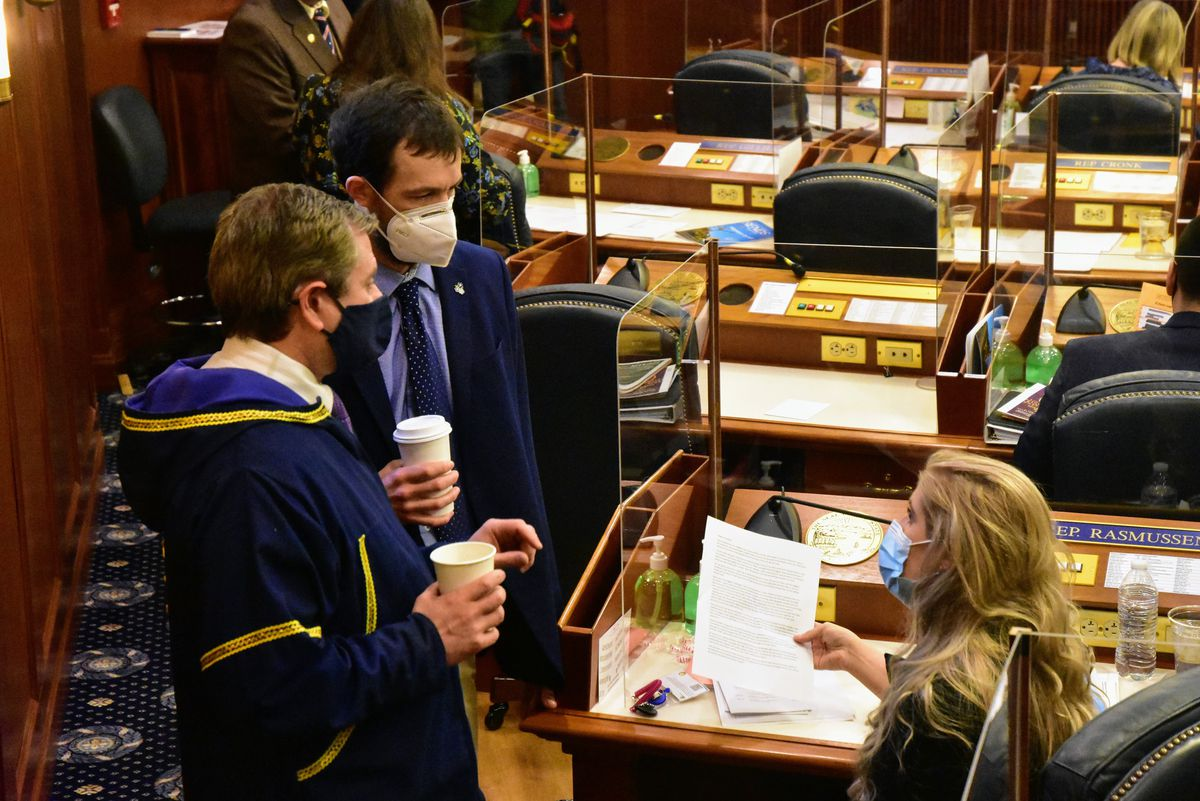 From left to right: Alaska state Reps. Chris Tuck, D-Anchorage, Zack Fields, D-Anchorage, and Sara Rasmussen, R-Anchorage, speak on the Alaska House floor on Friday, March 5, 2021, in Juneau, Alaska. The House passed a so-called Sense of the House on Friday, condemning as inappropriate and objectifying comments Fields had made toward Rasmussen last month. (Peter Segall/The Juneau Empire via AP, Pool)