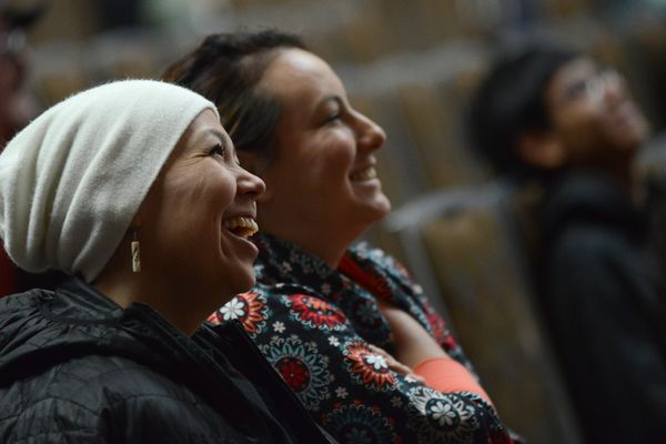 """Jone Ayyn Paoli, from Unalakleet, and Charlene Khaih Zhuu Stern, from Fairbanks and Arctic Village, listen to Ethel Lund during the Alaska Federation of Natives Convention at the Dena'ina Center in Anchorage, Alaska on Friday, Oct. 20, 2017. Lund, from Juneau, received the Della Keats """"Healing Hands"""" award for her work helping to establish the Southeast Alaska Health Consortium among other works. (Bob Hallinen / Alaska Dispatch News)"""