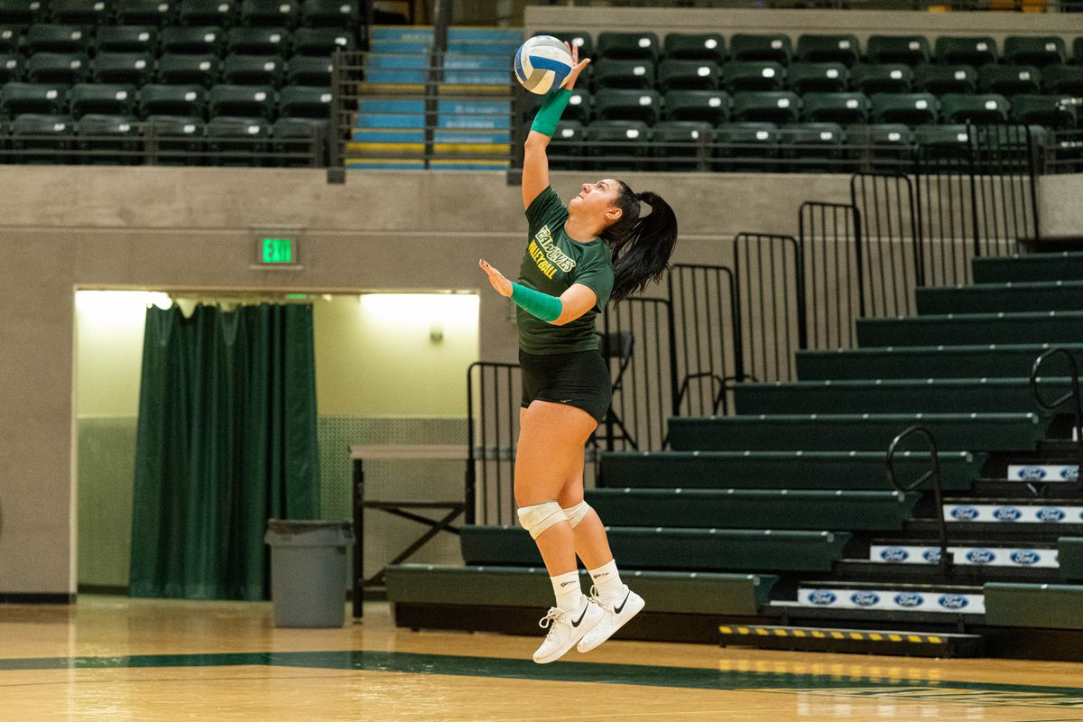 UAA freshman Maggie Schlueter serves during a practice last week at the Alaska Airlines Center. (Loren Holmes / ADN)