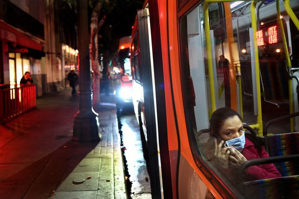 A passenger wears a mask on a bus in downtown Los Angeles. (Wally Skalij/Los Angeles Times/TNS)