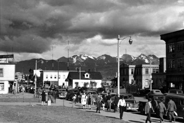 View of 4th Avenue and F Street, Anchorage, Alaska, looking south from the grounds of the Federal Building in the 1940s. Buildings shown include The Gitchell Hotel and City Hall. (Photo by Sidney H. Hamilton, Sidney Hamilton Photograph Collection; Anchorage Museum, Gift of Emily Turner, B1976.82.18.) ONE TIME USE Used Oct. 29, 2020, with permission from Anchorage Museum