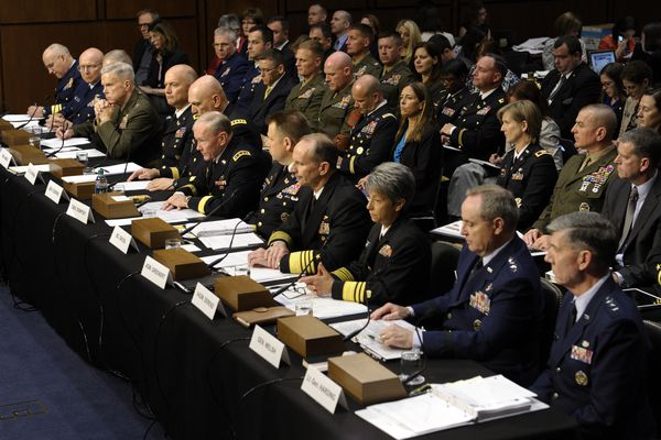Joint Chiefs Chairman Gen. Martin Dempsey, testifies on Capitol Hill in Washington, Tuesday, June 4, 2013, before the Senate Armed Services Committee hearing on pending legislation regarding sexual assaults in the military. At the witness table, from left are, Judge Advocate General of the Coast Guard Rear Adm. Frederick J. Kenney Jr.; Coast Guard Commandant Adm. Robert J. Papp Jr.; Staff Judge Advocate to the Marine Corps Commandant Maj. Gen. Vaughn A. Ary; Marine Corps Commandant Gen. James F. Amos; Judge Advocate General of the Army Lt. Gen. Dana K. Chipman; Army Chief of Staff Gen. Ray Odierno; Dempsey; Legal Counsel to the Chairman of the Joint Chiefs of Staff Brig. Gen. Richard C. Gross; Chief of Naval Operations Adm. Jonathan W. Greenert; Judge Advocate General of the Navy Vice Adm. Nanette M. DeRenzi; Air Force Chief of Staff Gen. Mark A. Welsh III; and Judge Advocate General of the Air Force Lt. Gen. Richard C. Harding. (AP Photo/Susan Walsh)