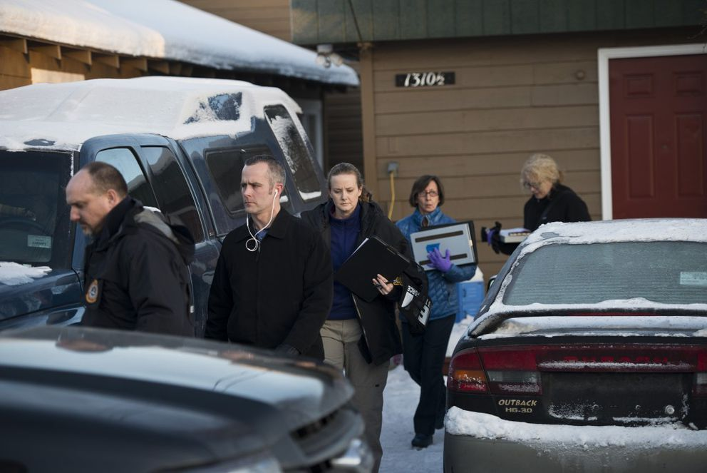 FBI agents come out of a home at 1310 1/2 Medfra Street in Anchorage, where Esteban Santiago lived. Esteban Santiago was arrested following a shooting in Fort Lauderdale, Florida, that killed at least five people, Jan. 6, 2017. (Marc Lester / Alaska Dispatch News)