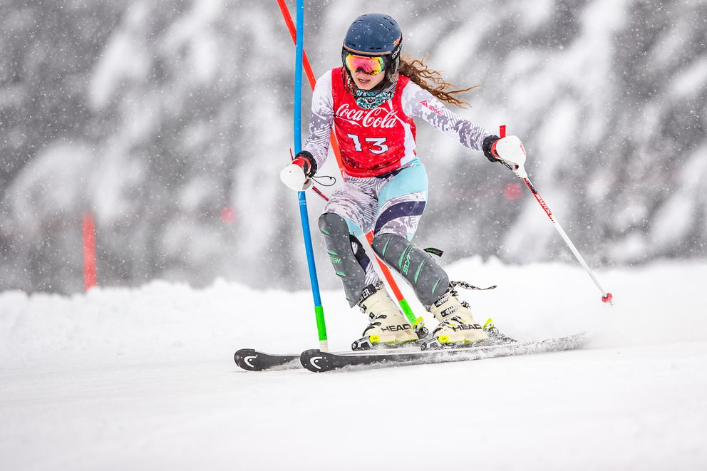 Kennedy Kane slides past two gates as powdery snow fall lightly during Monday's slalom race in the Coca-Cola Classic at Alyeska. Kane won both runs to take the women's overall victory. (Photo by Bob Eastaugh)