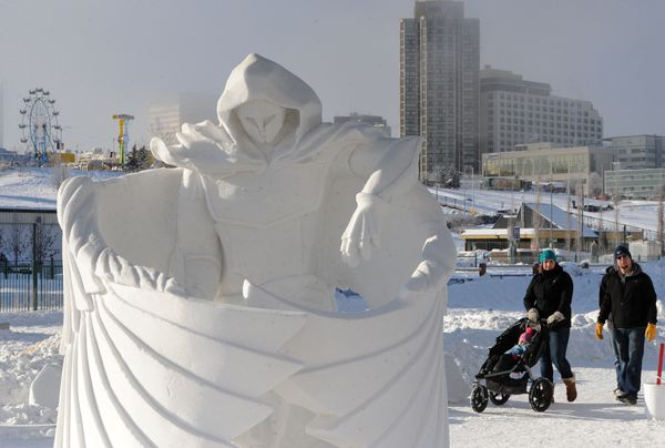 """""""Guardian Angel"""" by AK Awesome won the Team of Three division during judging of the Alaska State Snow Sculpture Championship on Sunday, Feb. 25, 2018, during the Fur Rondy winter festival earning them a trip to the U.S. National Snow Sculpture Competition. (Bill Roth / ADN)"""