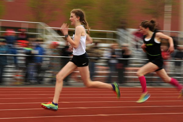 Emily Walsh, of Eagle River, holds off a strong challenge from Ava Earl, of South High, to win the 1600 m Cook Inlet Conference Championship at Dimond High on Saturday, May 19, 2018. (Bob Hallinen / ADN)