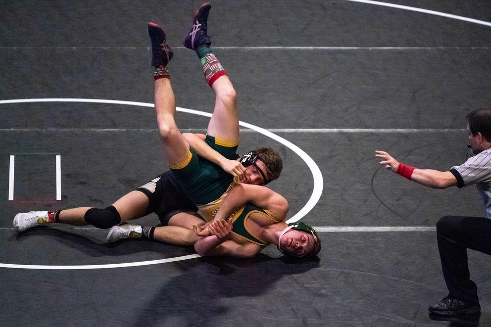 South's Riley Harris flips Services's Hayden Whitt on his way to the 145-pound title. (Loren Holmes / ADN)