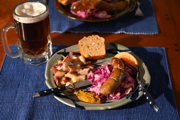 The House Box meal from Cafe Amsterdam includes two bratwursts, German potato salad, sautéed cabbage, beer bread and a house-made mustard. Photographed Oct. 14, 2020. (Anne Raup / ADN)