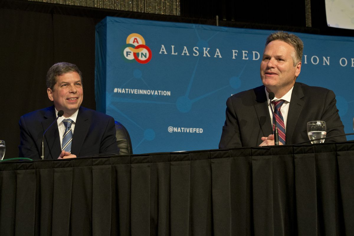 Gubernatorial candidates Mark Begich and Mike Dunleavy participate in a panel discussion at the Alaska Federation of Natives convention on Friday. (Marc Lester / ADN)