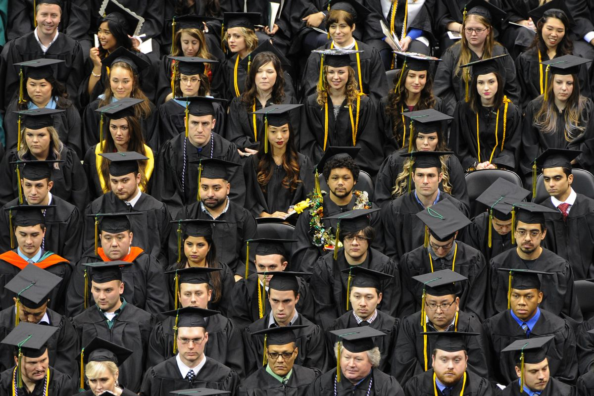 Around 400 graduates participated in the University of Alaska Anchorage class of 2016 fall commencement at the Alaska Airlines Center. Nearly 1,100 undergraduate, graduate and professional school students earning degrees were honored in the ceremony. (Bill Roth / Alaska Dispatch News)