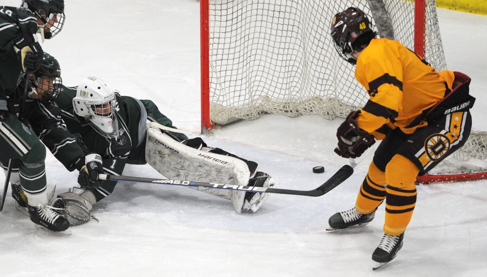 Dimond junior forward Teague Porter scores a goal against Colony goalie Bryant Marks Colony during the quarterfinals of the state hockey championships at the Menard Center in Wasilla on Thursday, Feb. 13, 2020. (Bill Roth / ADN)