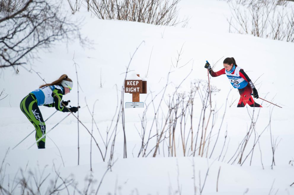 Colony's Lucy Shea, left, and Kenai's Summer Foster ski past each other during the girls 5K racec. (Loren Holmes / ADN)