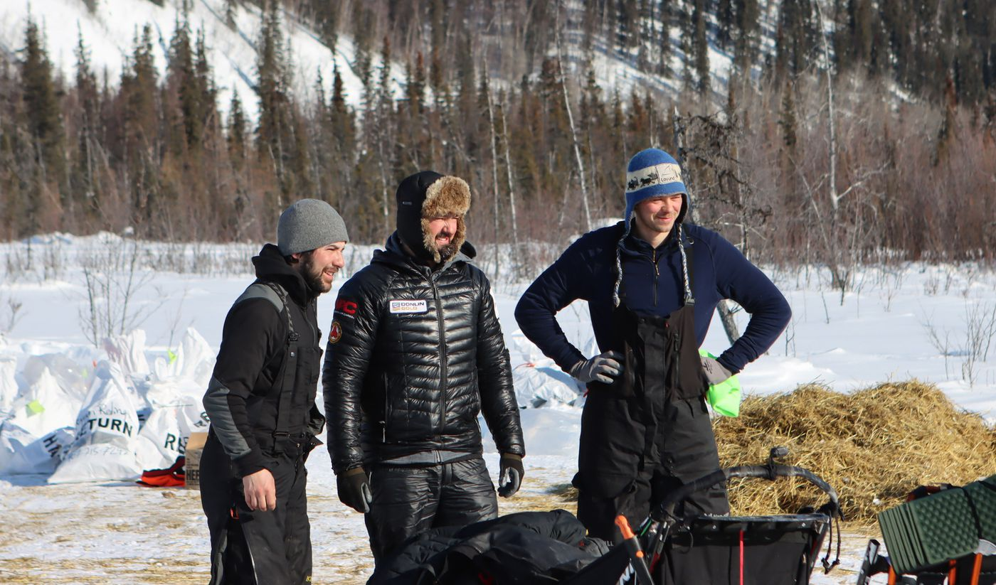 Past Iditarod champions Joar Leifseth Ulsom, right, and Pete Kaiser, middle, pose for a photo together with Richie Diehl in the Ophir checkpoint during the Iditarod on Friday March 12th. The three are close friends and have been traveling close together for sections of the race. (Zachariah Hughes/for ADN)