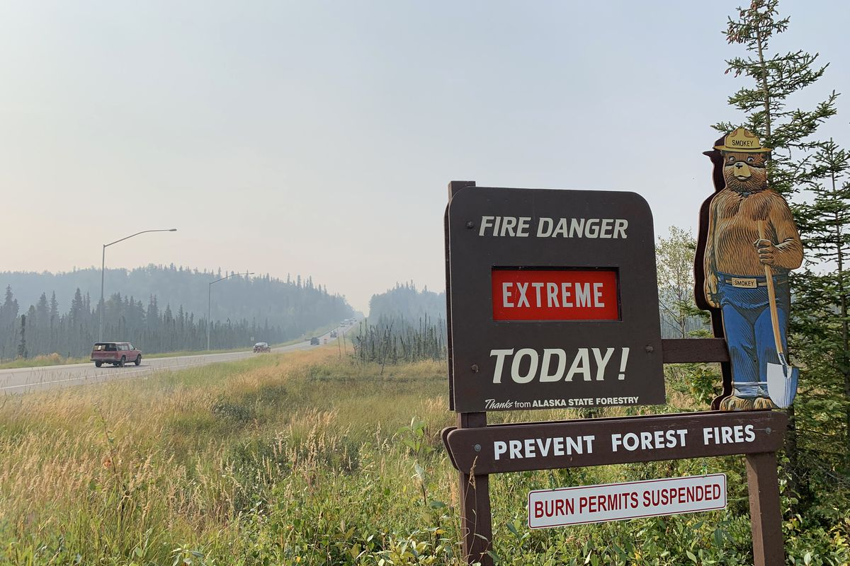 A sign warns motorists of extreme fire danger alongside the Sterling Highway in Soldotna on Thursday, Aug. 22, 2019. (Matt Tunseth / ADN)