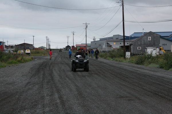 Four-wheelers roar past and kids head home just after the 11 p.m. curfew. on Friday, July 22, 2016, in the Southwestern Alaska village of Quinhagak. (Lisa Demer / Alaska Dispatch News)