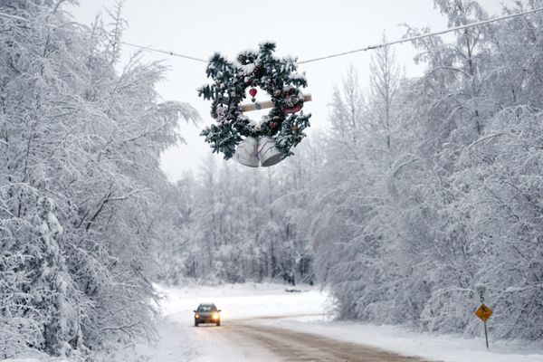 Pictured: A Christmas wreath hangs above the Willow Community Center Circle road on Dec. 23, 2014, at the intersection with the Parks Highway.