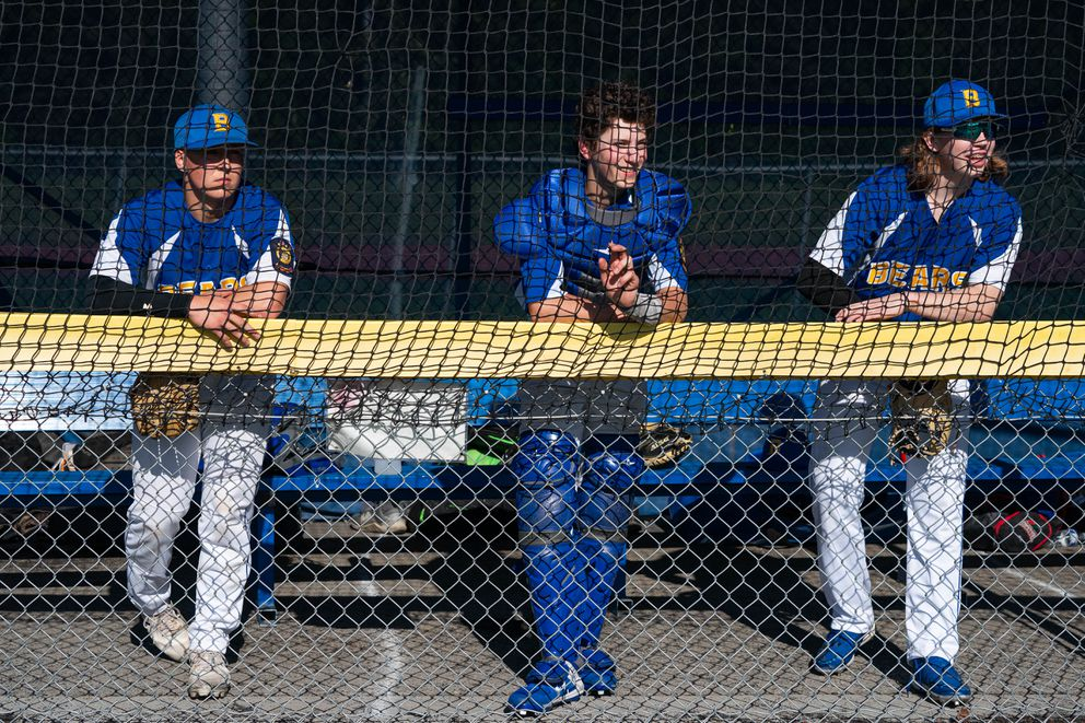 Bartlett players Blake Bacho, Eli Corwin and Luke Helgeson watch the action Friday during a game against Dimond at Bartlett High. (Loren Holmes / ADN)