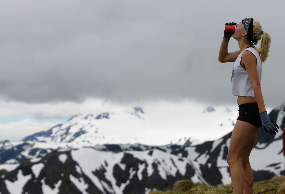 Denali Foldager Strabel, last year's runner-up shown here grabbing a drink atop Mount Marathon in the 2015 race, hopes to race Thursday. (Marc Lester / ADN archive)