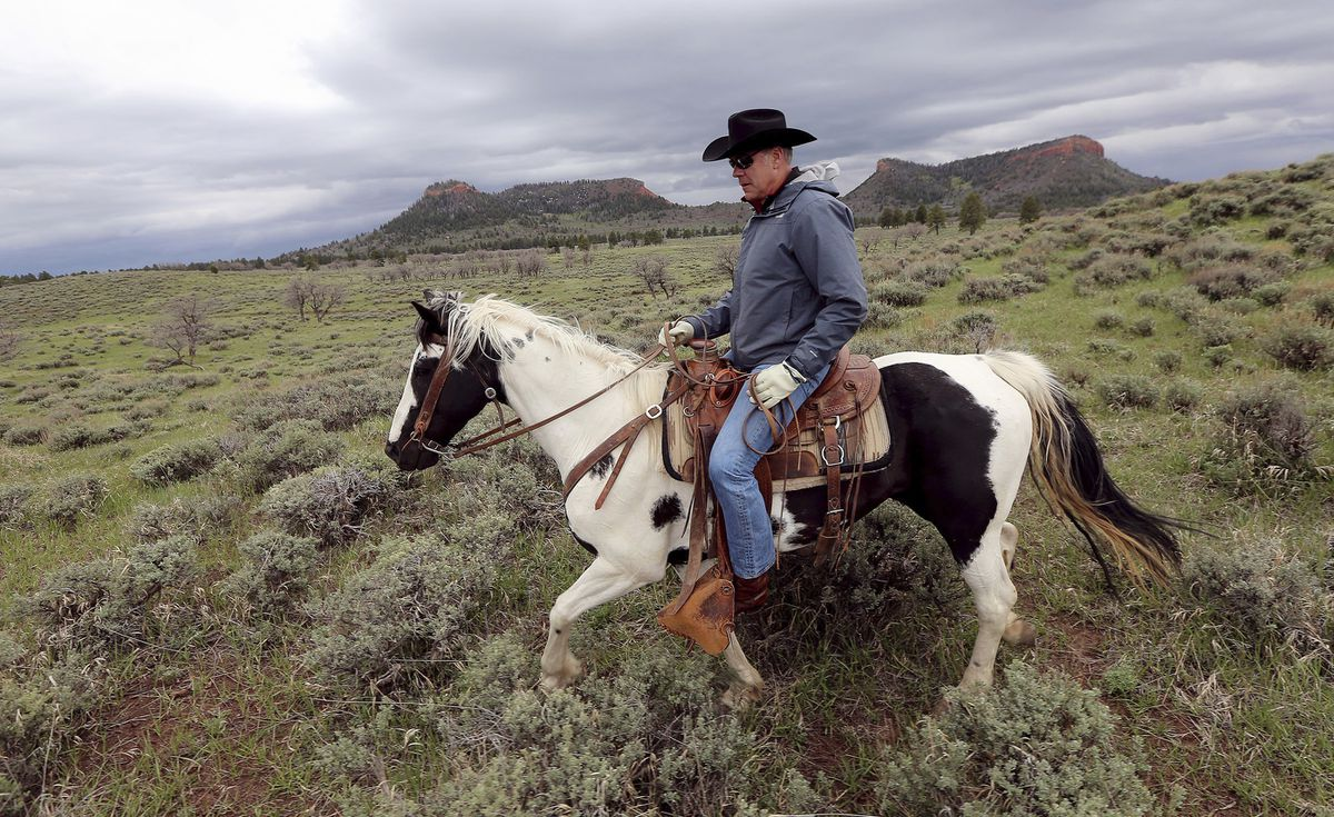 FILE - In this May 9, 2017, file photo, then Interior Secretary Ryan Zinke rides a horse in the new Bears Ears National Monument near Blanding, Utah. As former U.S. Interior Secretary Zinke exits Washington amid a cloud of unresolved ethics investigations, he says he has lived up to the conservation ideals of Teddy Roosevelt and insists the myriad allegations against him will be proven untrue. Zinke said he quit President Donald Trump's cabinet on his own terms, despite indications he was pressured by the White House to resign effective Wednesday, Jan. 2, 2019. (Scott G Winterton/The Deseret News via AP, File)