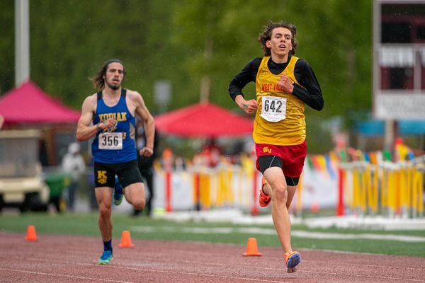 West Valley's Daniel Abramowicz leads Kodiak's Micah Fields in the 3200 meter final during the 2021 ASAA Track and Field State Championships on Friday, May 28, 2021 at Dimond High School in Anchorage. (Loren Holmes / ADN)
