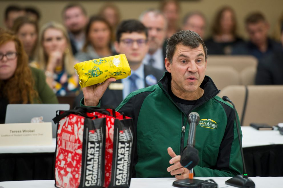 Tim Gravel, president of Kaladi Brother Coffee and a UAA alumnus, holds a UAA-branded bag of coffee. (Marc Lester / ADN)