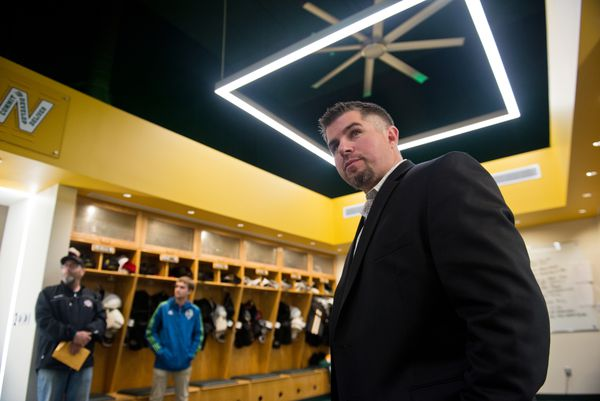 UAA hockey head coach Matt Thomas gives a tour of the new team locker room inside their training facility, the Brush Christiansen Hockey Center in September 2015. (Marc Lester / ADN archive 2015)
