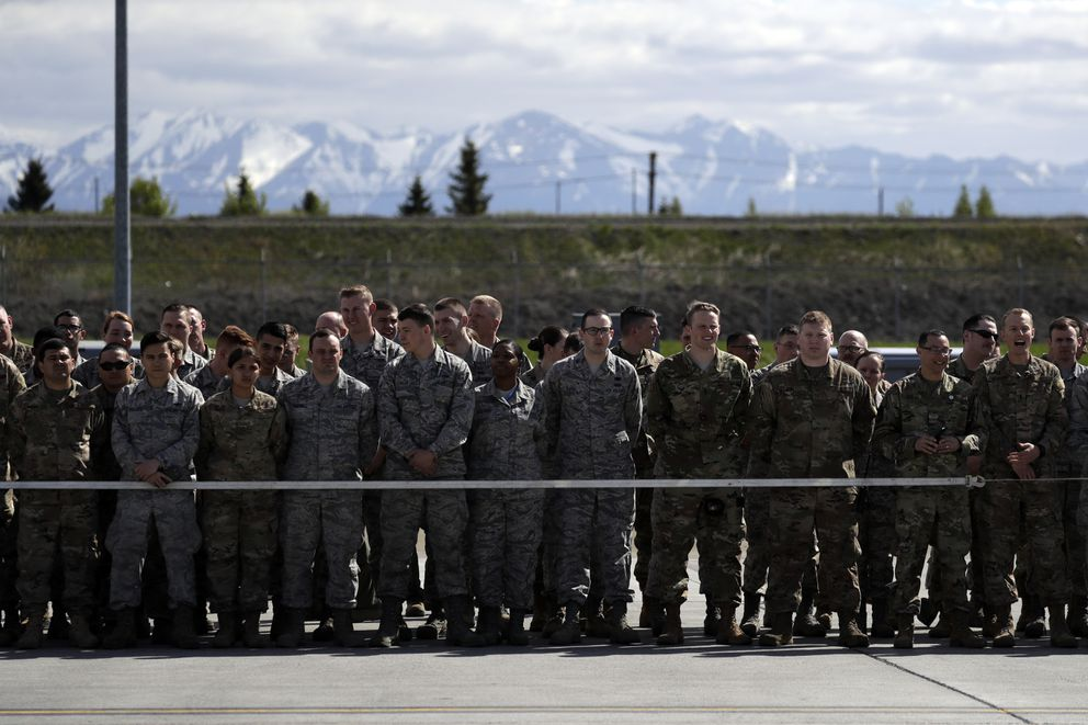 Troops wait for President Donald Trump after Air Force One landed at Joint Base Elmendorf-Richardson for a refueling stop en route to Japan. (AP Photo/Evan Vucci)