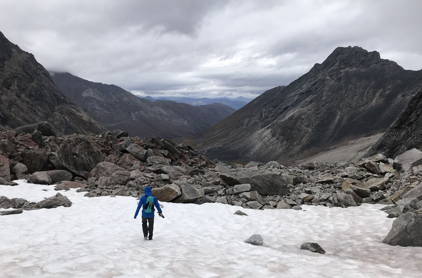 Jussi Ruottinen hikes across snow on Tuesday, Sept. 4, 2018. (Vicky Ho / ADN)