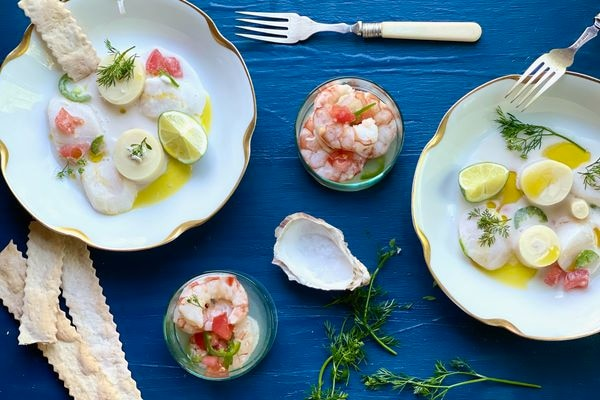 Scallop ceviche with hearts of palm, lime, and coconut and shrimp ceviche with tomato. (By Kim Sunée)