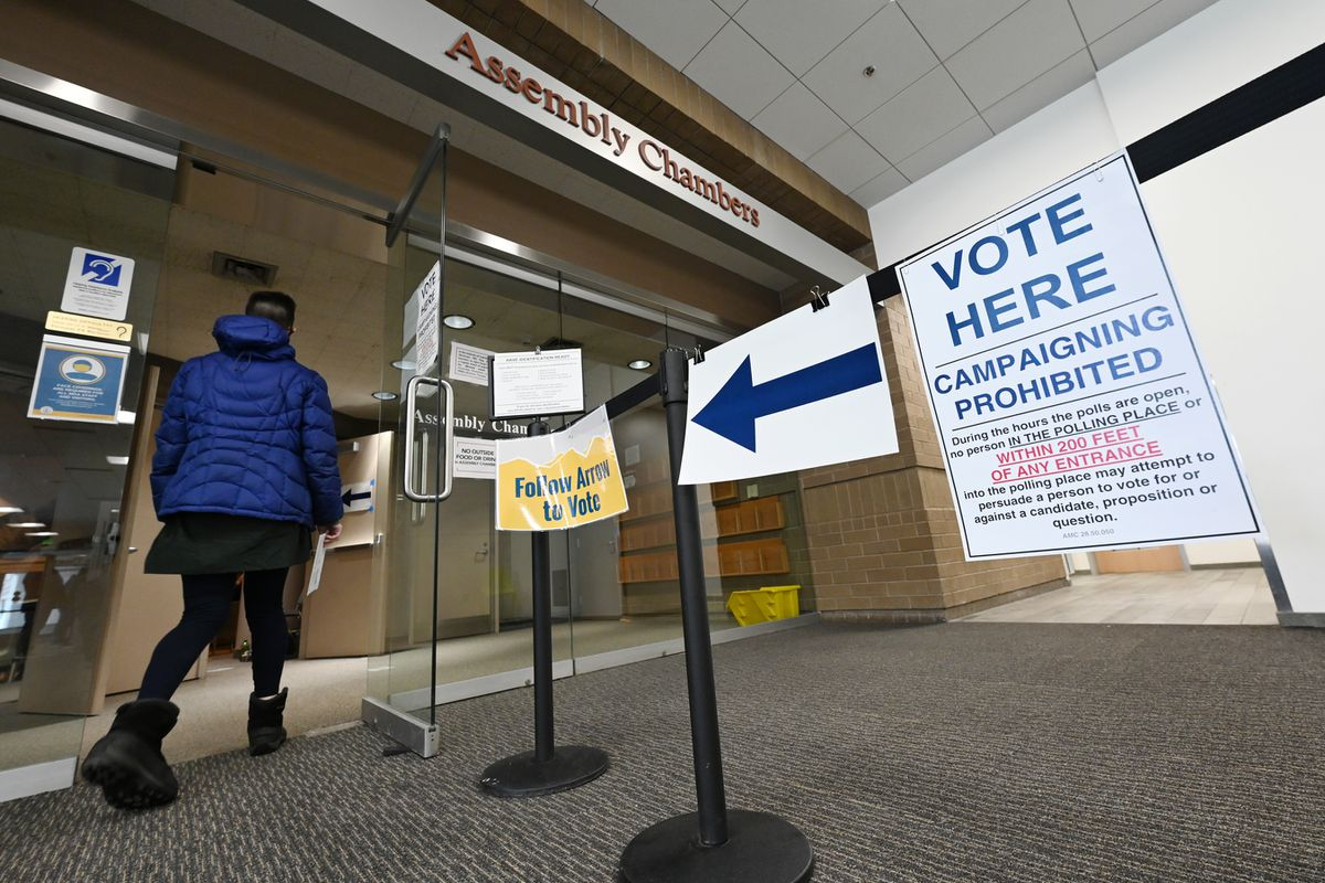 A voter drops off a vote-by-mail ballot for the regular municipal election at the Anchorage Vote Center in the Loussac Library on March 31, 2021. (Bill Roth / ADN)