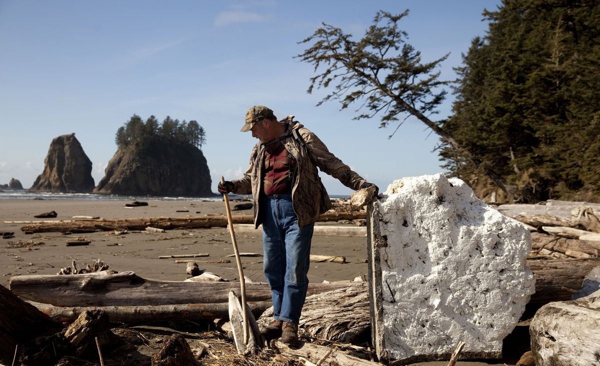 Longtime Forks resident John Anderson, who has been beachcombing the Olympic Peninsula since 1976, finds a Styrofoam piece of dock that likely came from Japan after the 2011 tsunami, March 7, 2013, along the Northwest coast. (Erika Schultz/Seattle Times/MCT)