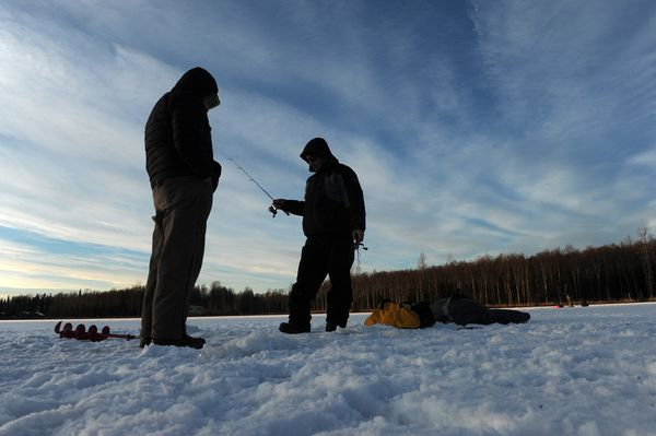 Kimberly Pingayak and Christopher Hale fish at DeLong Lake on Dec. 23. (Bob Hallinen / ADN)