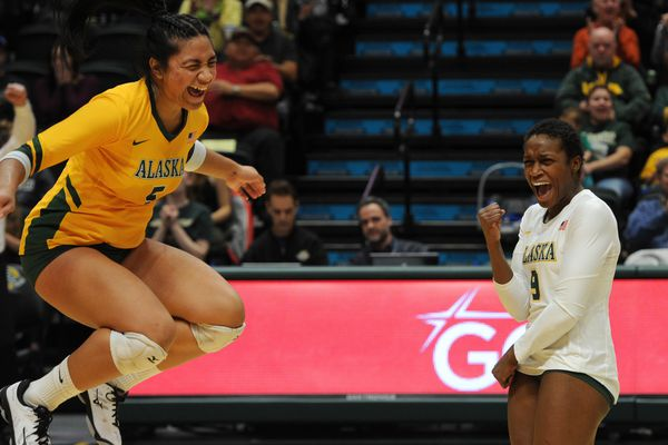 UAA seniors Taylor Noga and Chrisalyn Johnson celebrate a point a match against Seattle Pacific on Thursday, Nov. 1, 2018, at the Alaska Airlines Center. (Bill Roth / ADN)