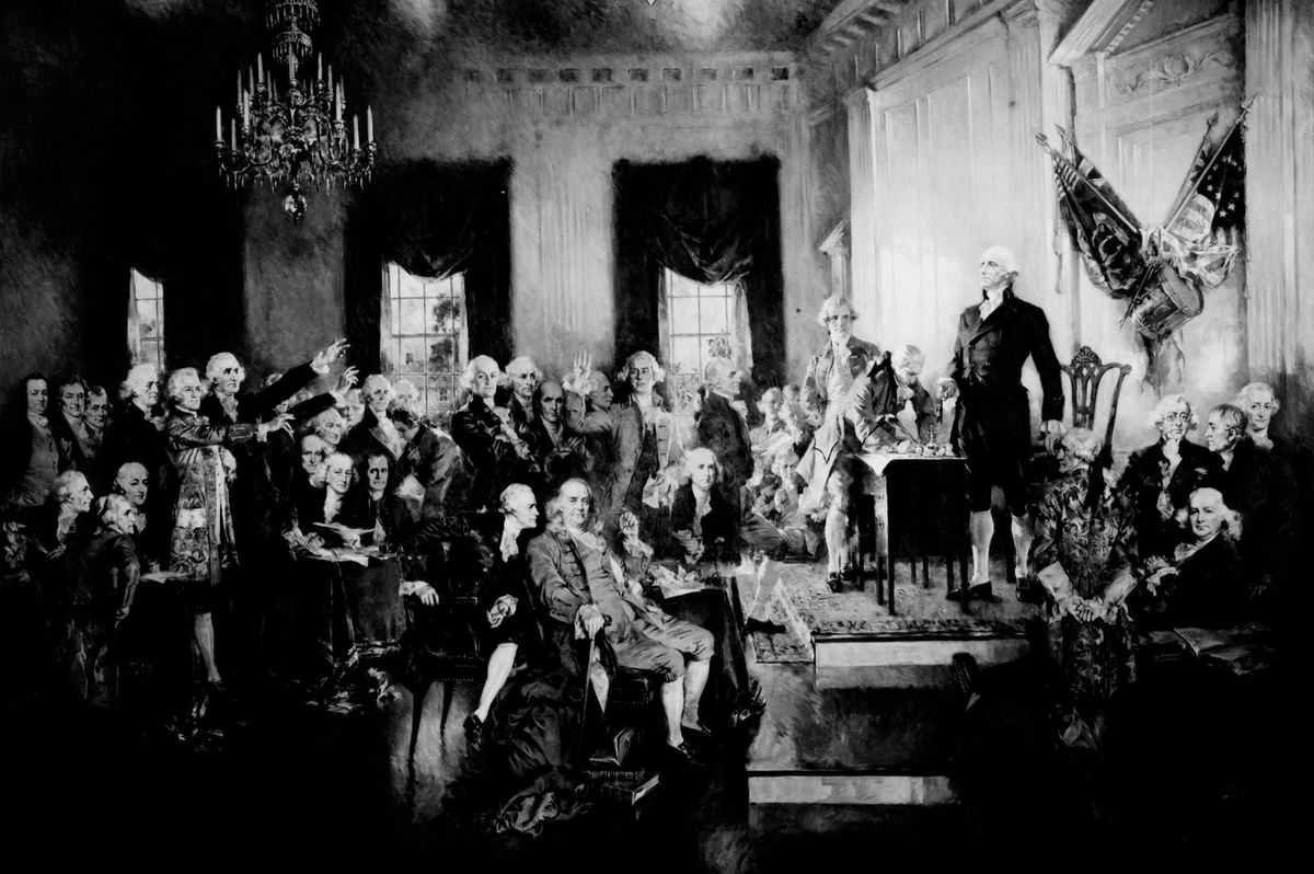 This photo provided by the Library of Congress shows a painting by Howard Chandler Christy of George Washington presiding at the signing of the Constitution of the United States in Philadelphia on Sept. 17, 1787. (Library of Congress via AP)