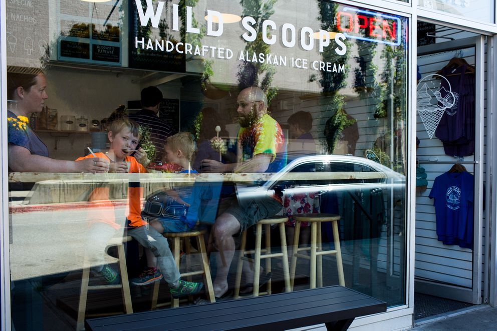 Christine and Zach Homan eat ice cream with their sons Leland, 4, and Colton, 6, at Wild Scoops in Anchorage. When asked about recent speculation that a missile from North Korea could reach Alaska, Christine Homan said that it is not a concern to her family. Other Alaskans shared the same sentiment. (Ash Adams for The Washington Post)