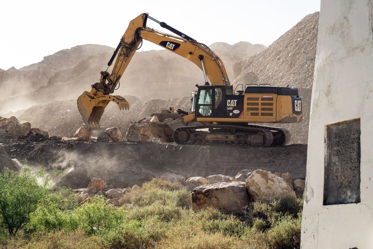 Trucks from Fisher Industries prepare the ground for a wall to be built on private property near El Paso, Texas. (Photo for The Washington Post by Jordyn Rozensky and Justin Hamel.)