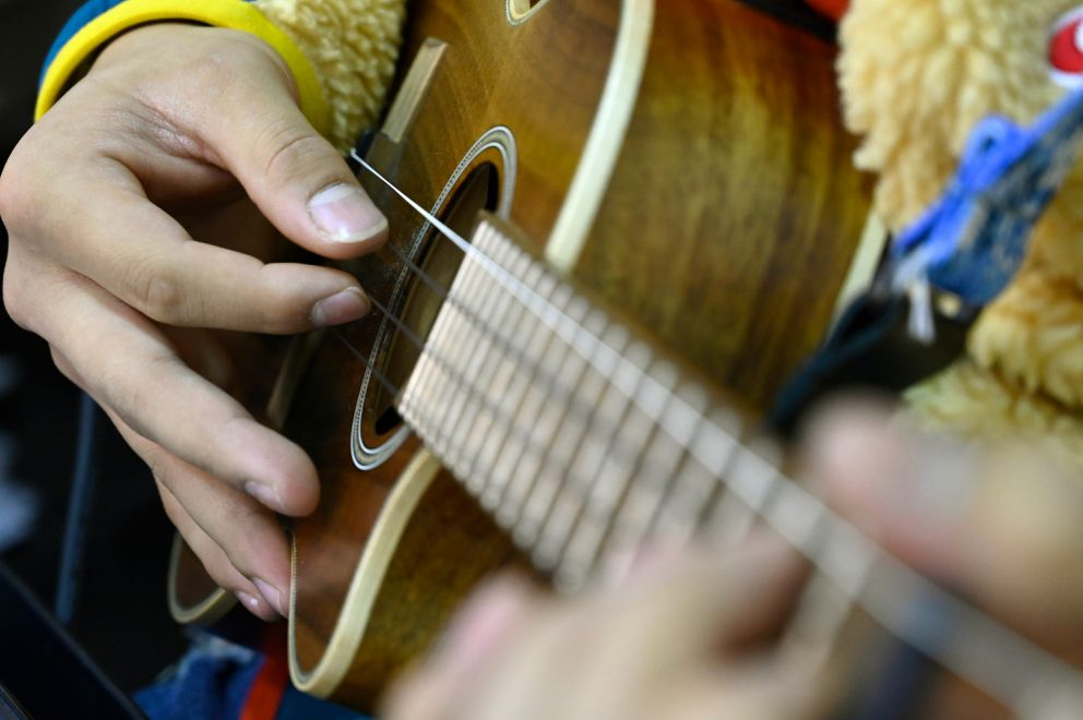 Kalani Medeiros, a senior, plays the ukulele with East High's ukulele orchestra on Nov. 20. (Marc Lester / ADN)