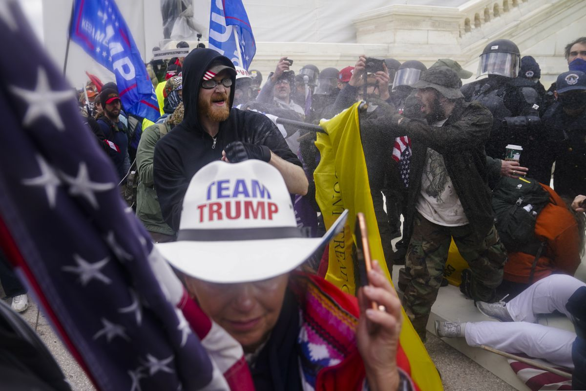 In this Jan. 6, 2021 photo, Trump supporters try to break through a police barrier at the Capitol in Washington. (AP Photo/John Minchillo, File)