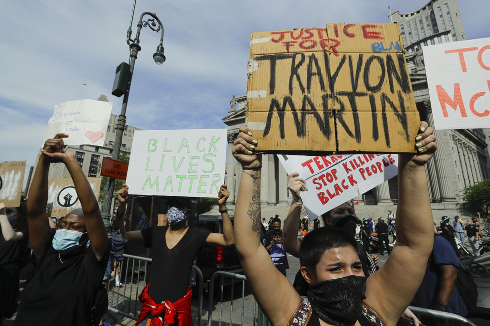 Protesters rally over the death of George Floyd, a black man who was in police custody in Minneapolis Friday, May 29, 2020, in New York. Floyd died after being restrained by Minneapolis police officers on Memorial Day. (AP Photo/Frank Franklin II)