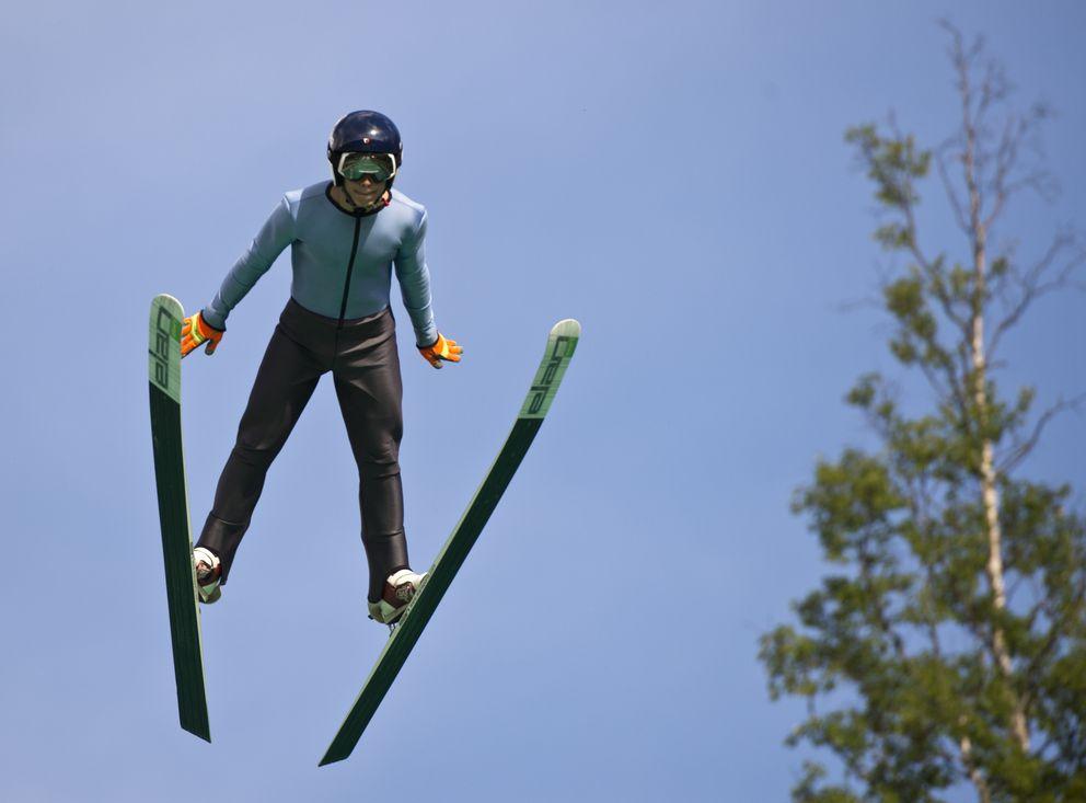 Carter Brubaker flies over the 65-meter ski jump at the Karl Eid Ski Jump Complex. (Marc Lester / ADN)