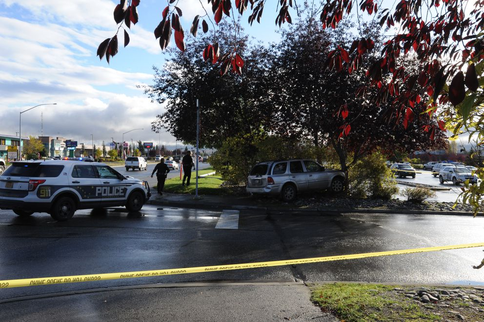 Anchorage officers exchanged gunfire with suspectsMonday morning nearDimond Boulevard and C Street, police said. The suspect vehicle came to rest at the entrance to Costco. (Bill Roth / Alaska Dispatch News)