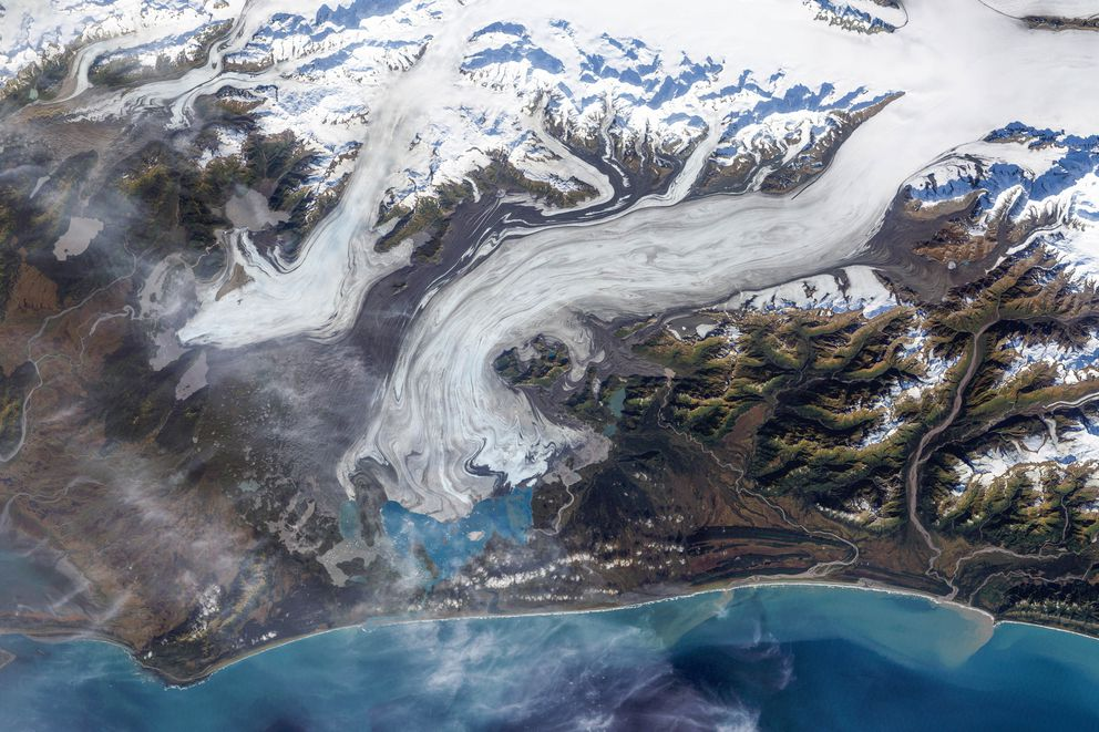In 2002 the Bering Glacier terminated in Vitus Lake south of Alaska's Wrangell-St. Elias National Park, about 10 km from the Gulf of Alaska. Higher temperatures and changes in precipitation over the past century have thinned the Bering Glacier by several hundred meters. This true-color image of the Bering Glacier terminus was acquired on September 29, 2002, by the Enhanced Thematic Mapper plus (ETM+) instrument aboard the USGS/NASA Landsat-7 satellite. (NASA)
