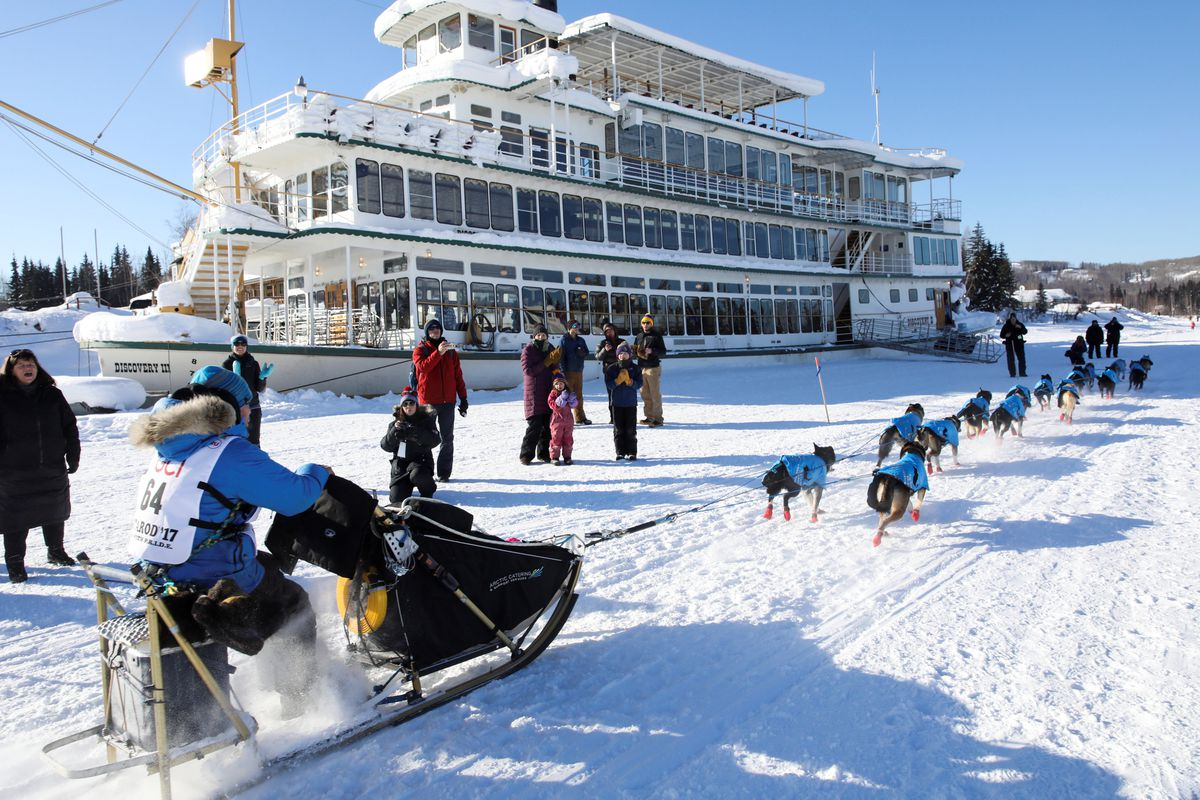 Jason Mackey competes in the Iditarodrestart Monday in Fairbanks. (Nathaniel Wilder / Reuters)