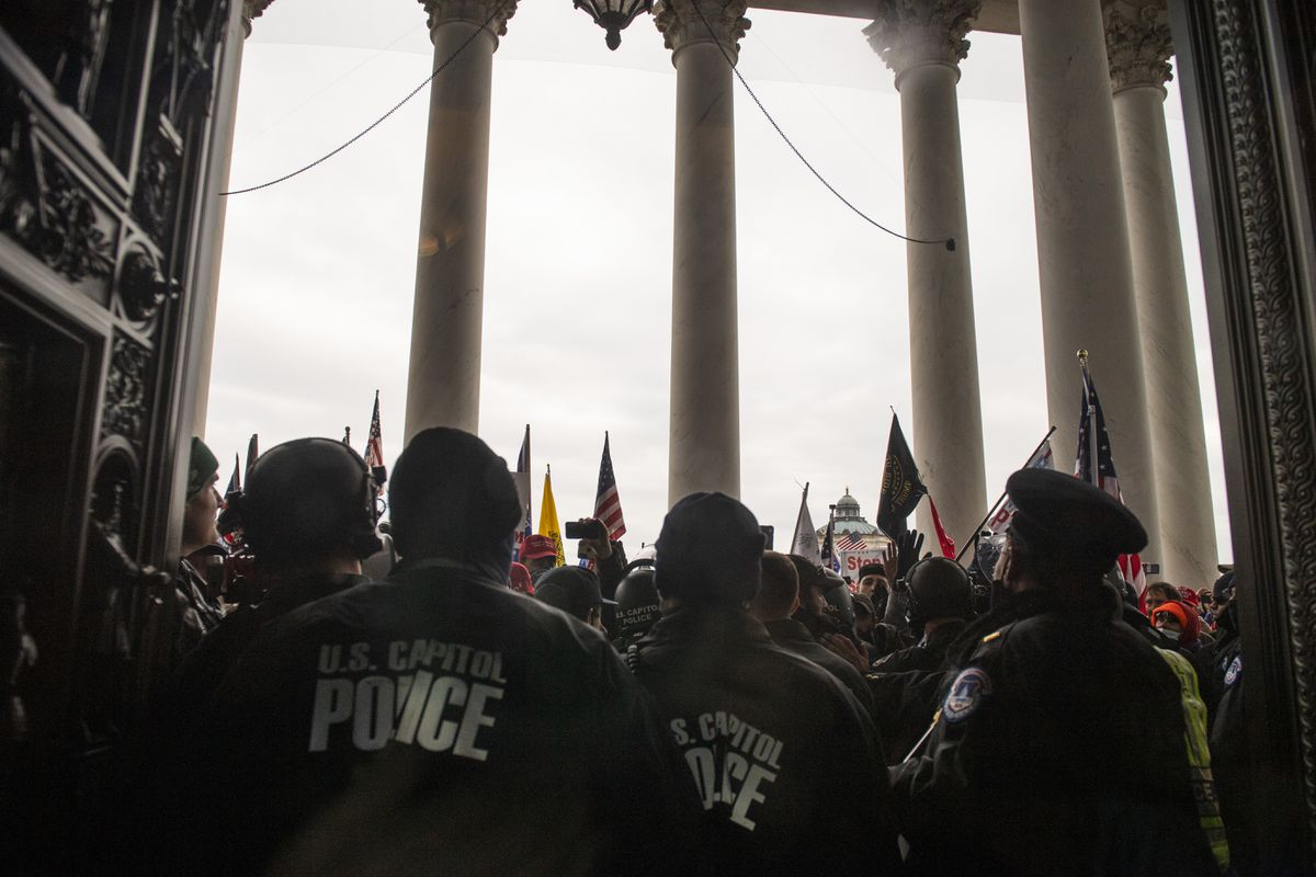 Rioters fight to gain access to the U.S. Capitol on Jan. 6. Photo by Amanda Voisard for The Washington Post.